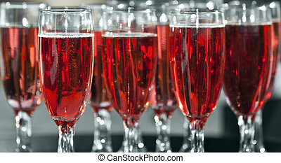 Champagne - Fruity champagne in glass flutes ready to be...