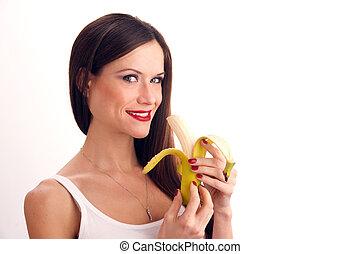 Woman eats Banana