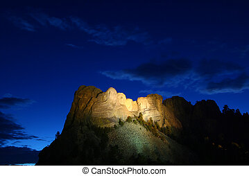 Mount Rushmore National Memorial illuminated under the...