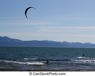 Two kite surfers in the bay - Two kit surfers on a windy...