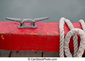 Cleat on the dock of the boat harbor with rope - Cleat on...