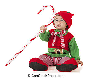 Candy Cane Elf - A cute toddler dressed as an elf holding...