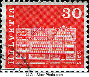 gabled house from Gais - SWITZERLAND - CIRCA 1968: A stamp...
