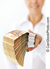 Woman with a stack of euro banknotes - Woman holding a stack...
