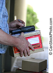 Delivery - Parcel delivery with hand signature on handheld...