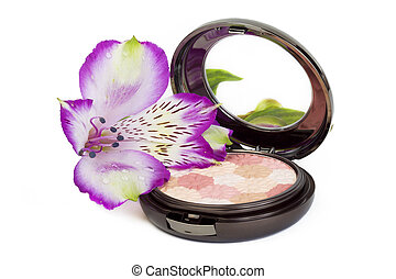 Pressed powder in a package and a delicate fresh flower