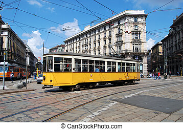 Typical tram (streetcar) in Milan square - Piazza Cordusio,...