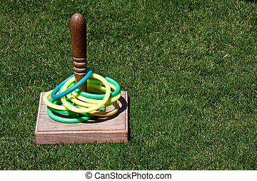 Ring Toss Game in Grass Lawn - A classic game of ring toss...