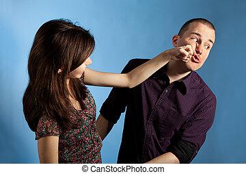 Women punching men - Young woman punching men in a face