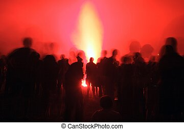 crowd silhouette at pyrotechnics show - long shutter...