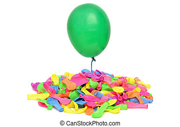 Escaping - floating green balloon over pile of balloons