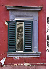 naples - the statue in the window, Naples, Italy