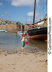 Child beach harbor Cornwall boat Mousehole