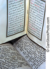 Ancient Bible and Koran - Ancient copy of the The Holy Bible...