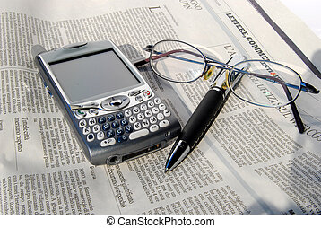 Cell phone, glasses and pen