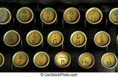 Old typewriter, detail - A typewriter is a mechanical or...