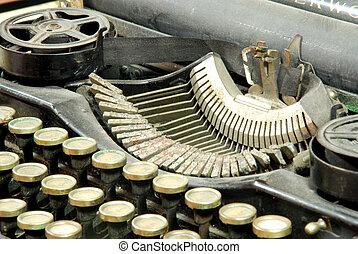 Old typewriter, detail - A typewriter is a mechanical or...