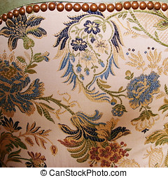Antique brocade chair covering - The back of an antique...