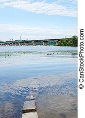 Ukraine, Kiev, Paton bridge over Dnipro river with stones,...