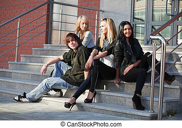 Teens on the steps - Young people relaxing on the steps