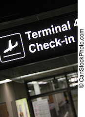 Check in - airport terminal corridor with check in banner