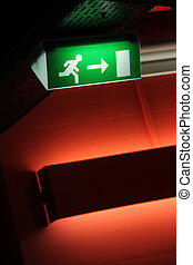 emergency exit - green emergency exit sign with red wall