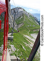 rack railroad - red swiss rack railroad in the mountains