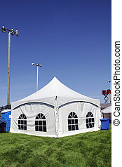 White tent on grass vertical - Celebration or event: White...