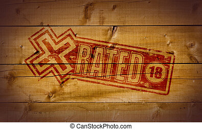 X Rated impression on wooden background