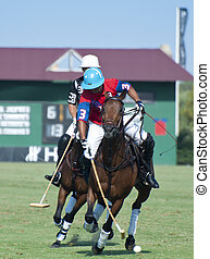 Polo Players - Two polo players on horseback caught in the...