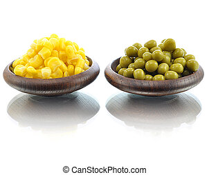 peas and corn in wooden bowls