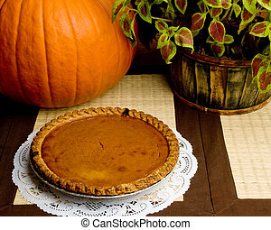 Pumpkin Pie - A fresh pumpkin pie on display alongside a...