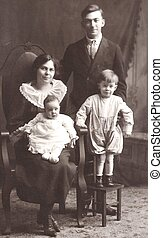 AN OLD TIME FAMILY - A mother, father, and two children pose...