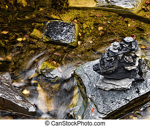 Stacked stones in a riverbed. - Stacked stones in a riverbed...