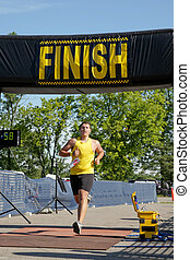 Finish Line - Triathlete crosses the finish line