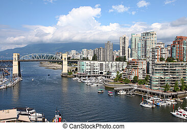 Old bridge and high rises Granville - A panoramic view of an...