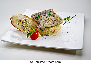 Pike-perch fillet garnished with vegetables and toast,...