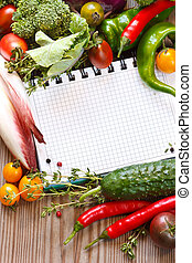 Notebook and  vegetables.