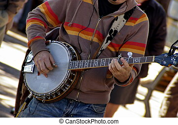 banjo - a banjo player on a street