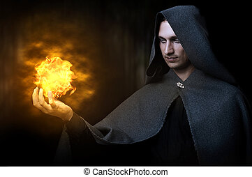 Halloween concept. Male wizard with fireball - Halloween...