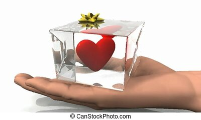 Hand holding glass cube with rotating heart inside