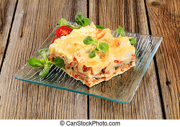 Tasty lasagna - Portion of tasty lasagna on a plate