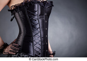 Close-up of woman in black corset, copy-space for your text