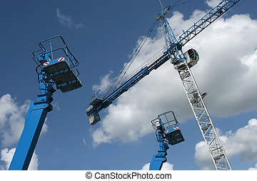 Crane And Lifts - Crane and telescopic people lifts against...