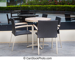 Coffe table with three rattan chairs, at shenzhen, china