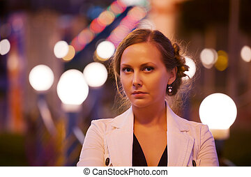 Young woman on the night city street