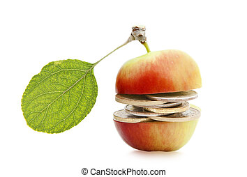 Money in the middle of an apple isolated on a white