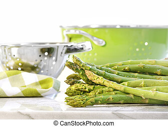 Green asparagus on marble table - Fresh green asparagus on...