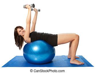 Yoing women doing weight training