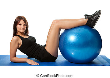 Young women doing crunches on fitness ball. Isolated on...